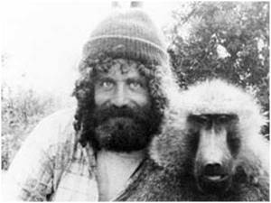 Sapolsky with one of the baboons he studied (and proof we're all related).